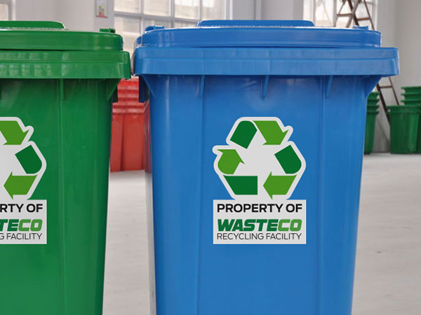 Permanent stickers on recycling and garbage bins