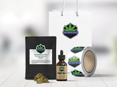 Custom cannabis packaging labels on a bag of cannabis and jars of cannabis