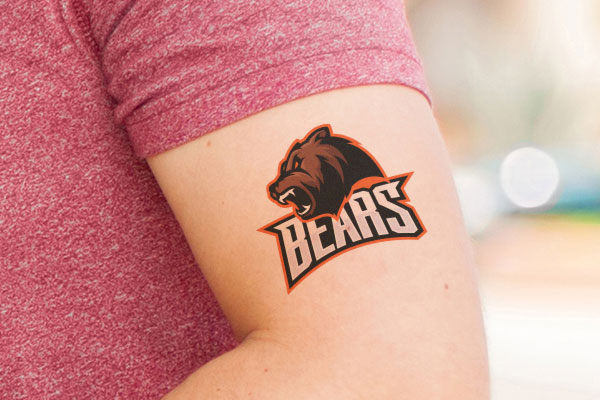 Sports team logo temporary tattoo on a mans arm