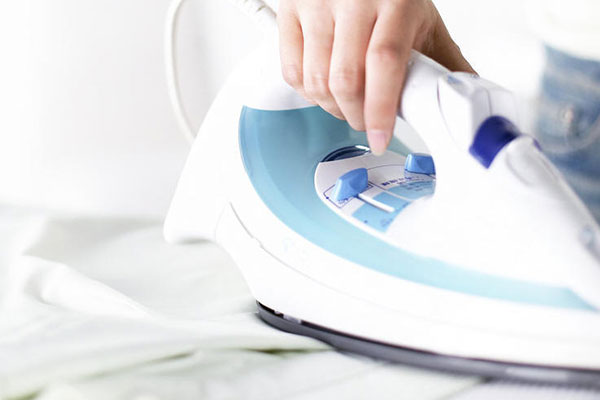 Person ironing