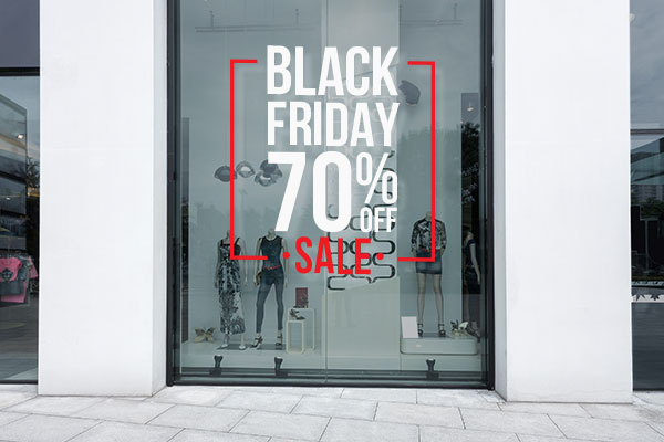Vinyl lettering on a storefront window advertising a Black Friday sale.