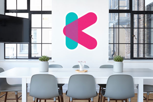 Logo wall decal in an office boardroom