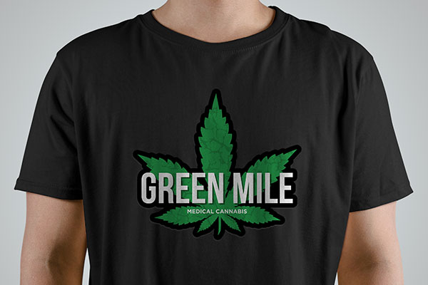 Custom cannabis logo iron-on graphic on a black t-shirt
