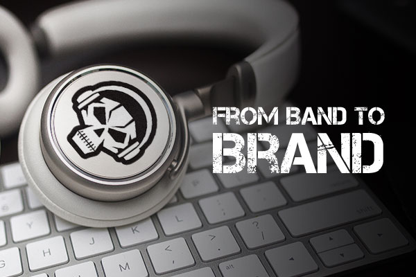 Custom die-cut band logo sticker on a pair of headphones