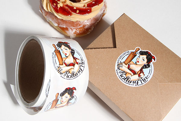 Bakery logo sticker sealing a box