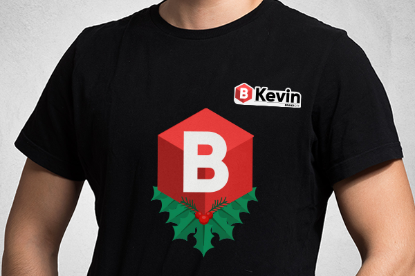 Holiday themed iron-on and badge on employee t-shirt