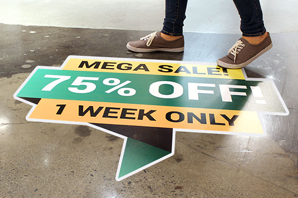 Floor decal advertising a sale
