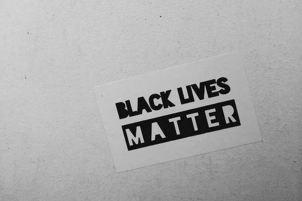 Black lives matter sticker on a wall
