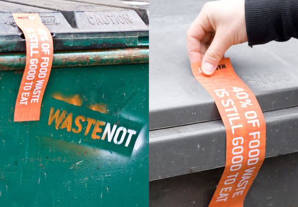 Food waste awareness sticker on a dumpster