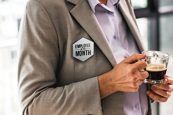 Employee of the month badge being worn