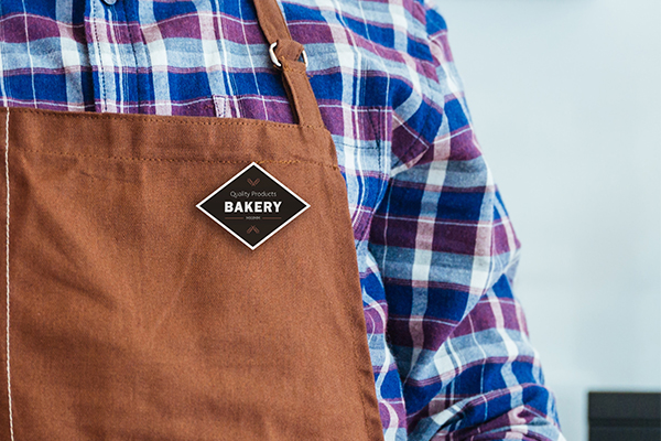 Bakery employee wearing a name badge