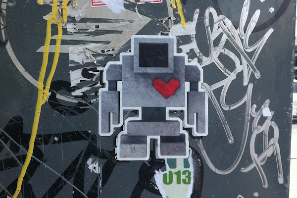 Lovebot sticker on a wall