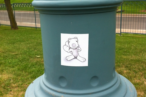 Earl the Angry Squirrel sticker on a lamppost