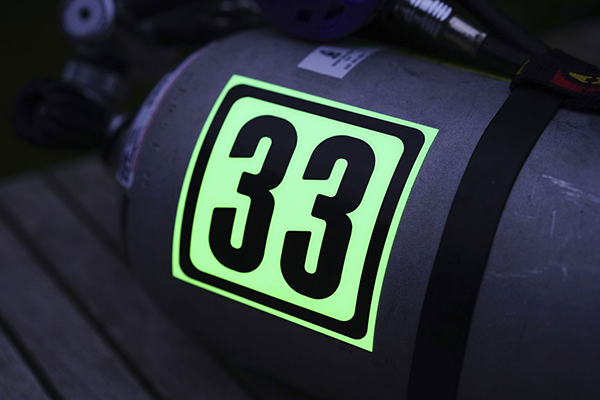 Glow in the dark sticker on safety equipment