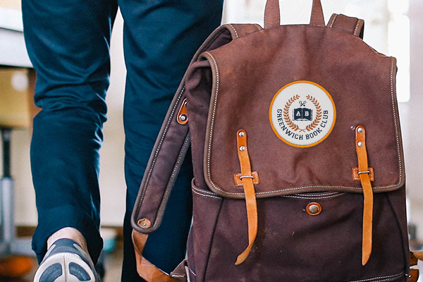Book club patch on backpack