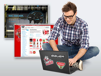 Young man on laptop viewing StickerYou brand partner pages