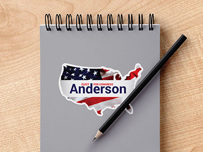 Custom political campaign sticker on a notebook