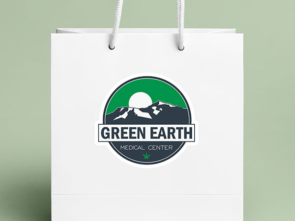 Dispensary logo sticker on a paper shopping bag