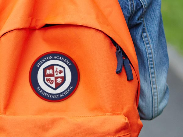School logo patch on a students backpack