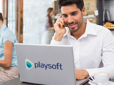 Smiling sales rep talking on phone and working on laptop