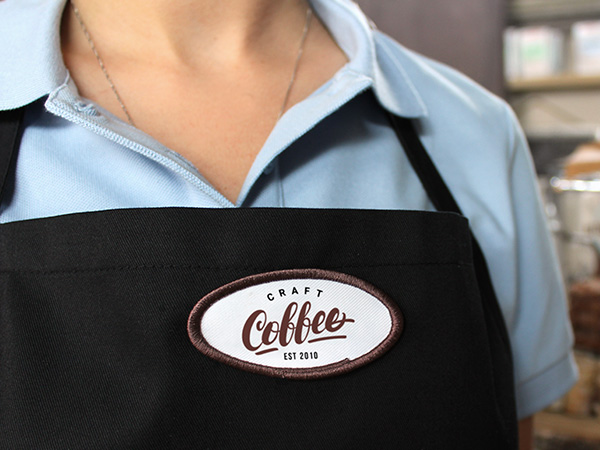 Coffee shop logo patch applied to a uniform apron