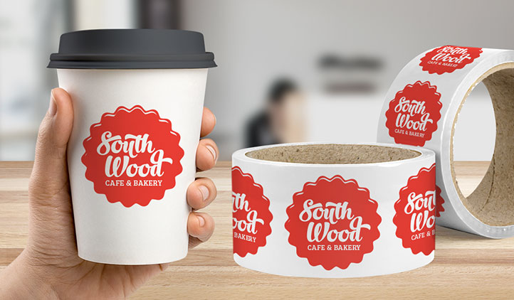 Paper roll labels on a coffee cup