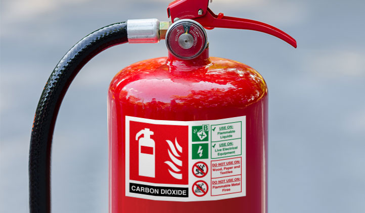 Permanent safety sticker on a fire extinguisher