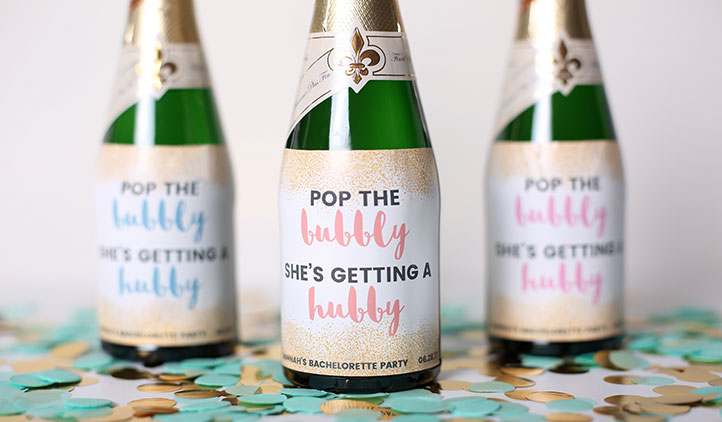 Custom wedding labels on champagne bottles