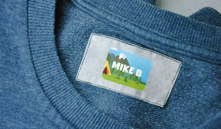 Permanent name tag sticker on a clothing tag label