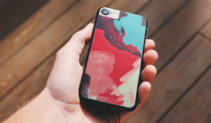 Custom vinyl iPhone skin with an artistic background