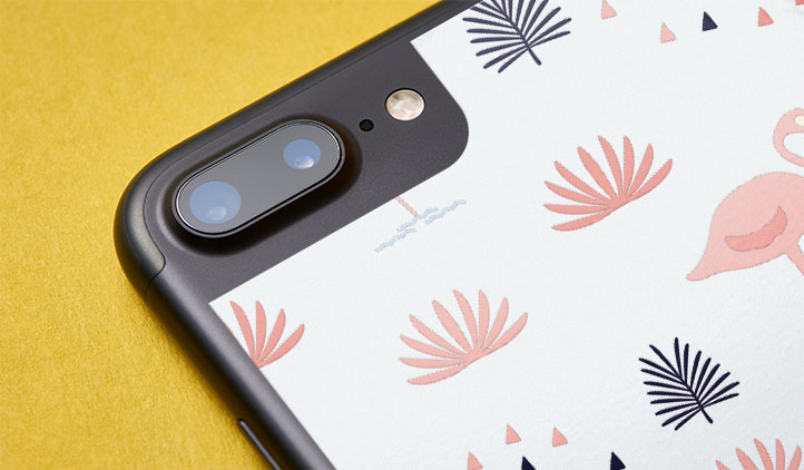 Close-up of a custom vinyl iPhone skin with an artistic pattern