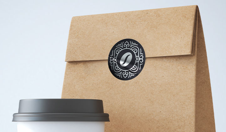 Silver foil label sealing a coffee bag