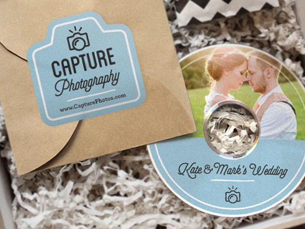 A personalized wedding CD label and a photography studio logo on a sealed envelope