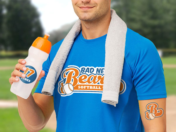 Man wearing a t-shirt with a team logo iron-on and holding a water bottle with a team logo sticker
