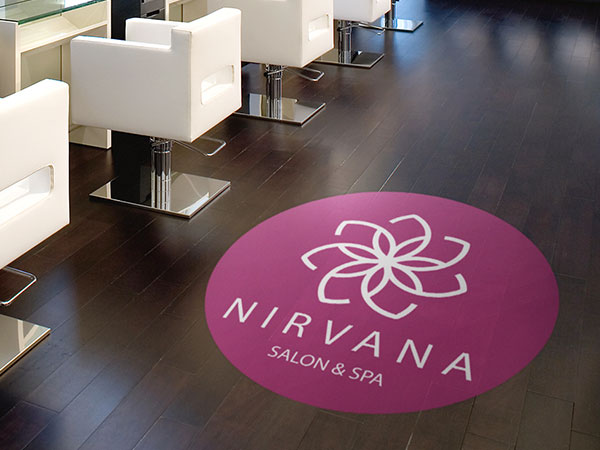 Logo decal on a salon floor