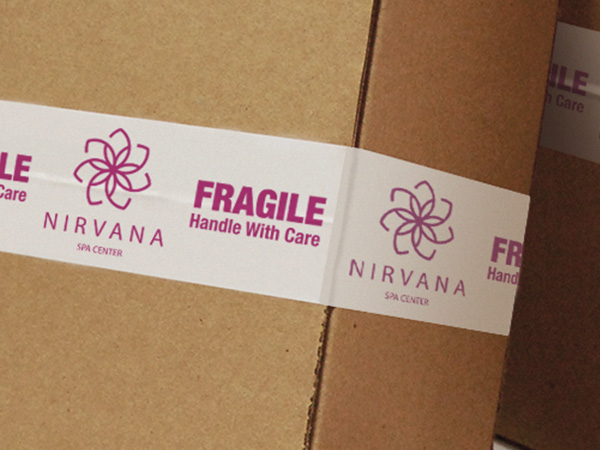 Custom branded packing tape sealing a box