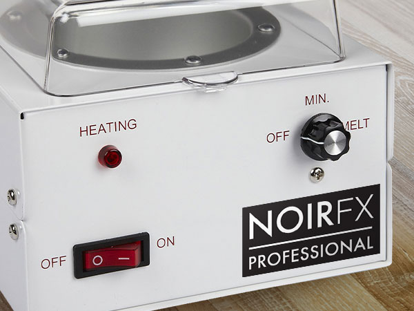 Permanent spa logo sticker on a wax heater