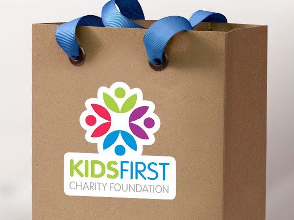 Kids charity logo sticker on a paper gift bag