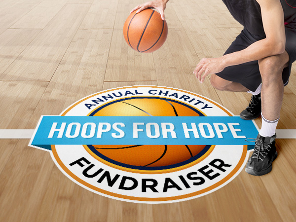 School sports fundraiser decal on a school gymnasium floor