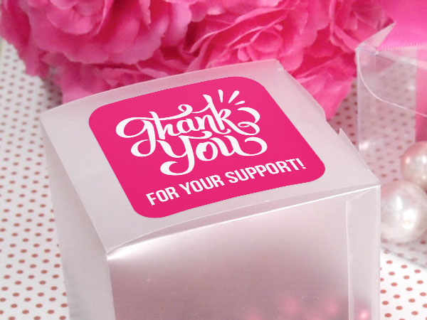 Thank you sticker on a small gift box