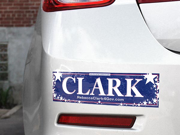 Political bumper sticker on a car bumper