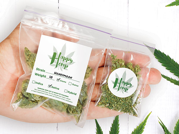 Dispensary logo stickers on a bags of marijuana