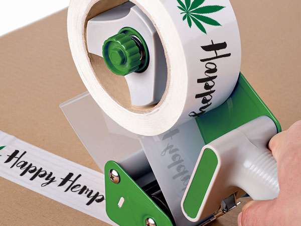 Dispensary logo packing tape sealing a cardboard box