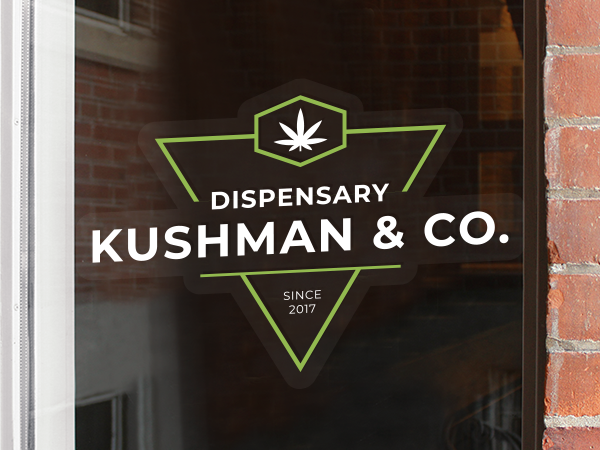Clear dispensary logo decal on a window