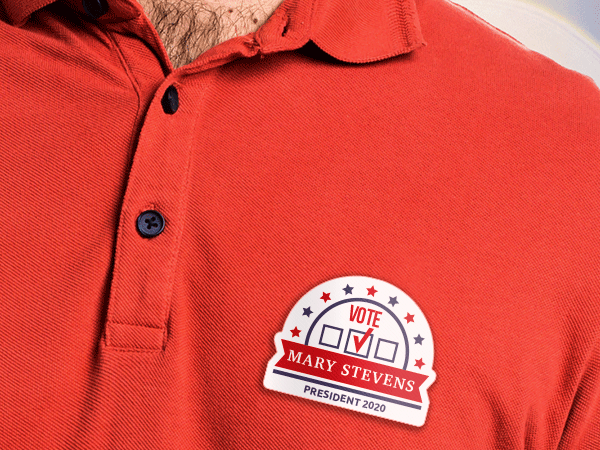 Political campaign badge on a red polo shirt