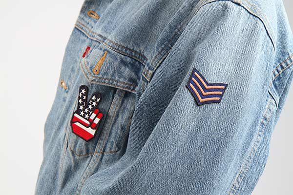 Jean jacket with patches on it